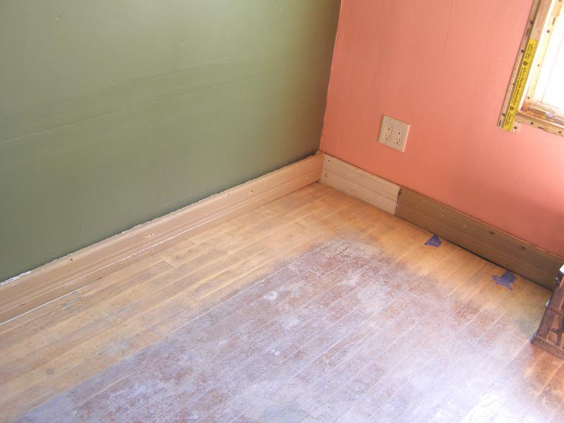 sanding floor and baseboards.jpg
