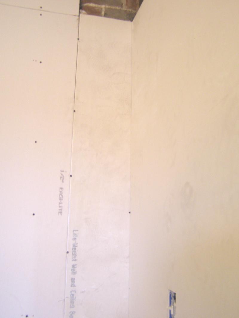 chimney corner covered w drywall.jpg
