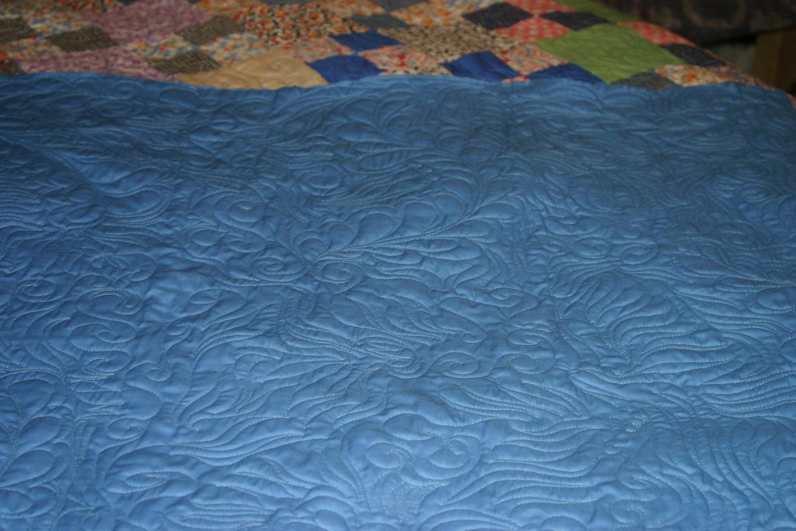 back showing quilting detail.